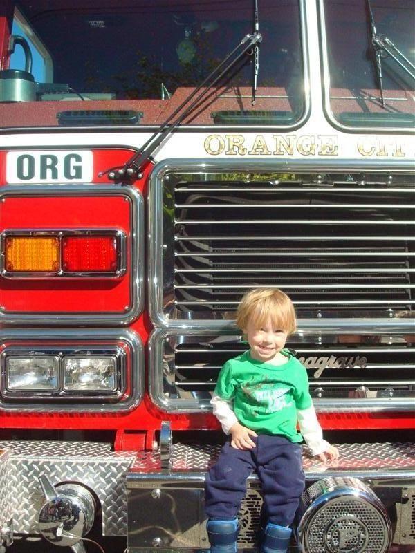 cv-preschool-toddler-on-a-fire-truck