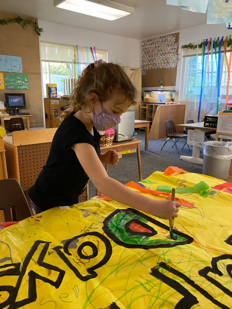 Painting preschool poster for 100 days celebration